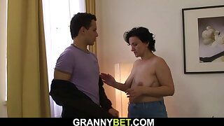 Old brunette grandma picked up to ride his dick