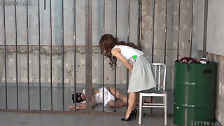 BDSM sub flagellated and spanked by dominatrix