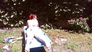 Nicoletta wears a large diaper in a public garden