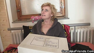 Lean mature woman with small tits satisfies two studs