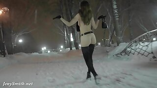 Jeny Smith bare in snow fall walking through the city