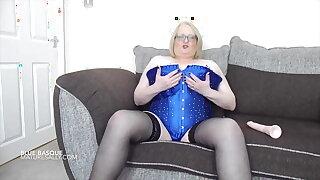 Sally in her blue basque giving a dildo a titwank