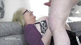 Young man cums on Grandma's big tits