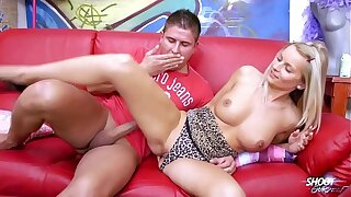 Blonde sexbomb with perfect melons rock the cock on the sofa