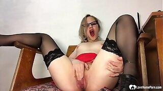 Kinky secretary in stockings pleasures her sugary-sweet honeypot